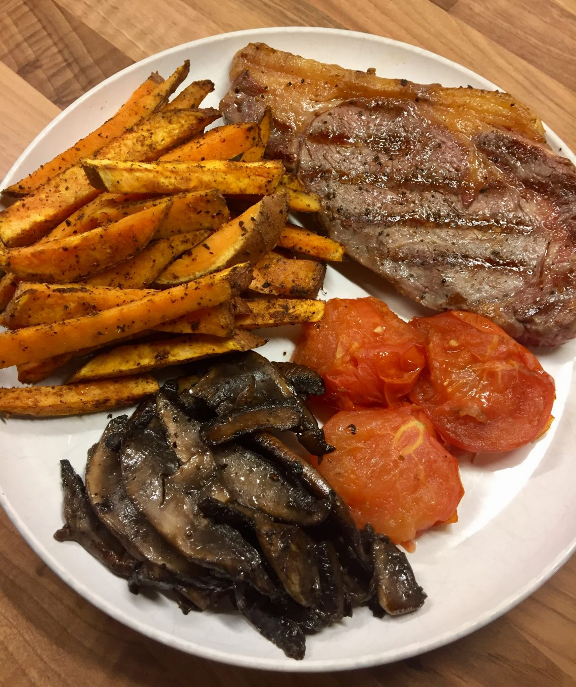 Steak with Cajun Sweet Potato Fries, Roasted Tomatoes and Fried Mushrooms
